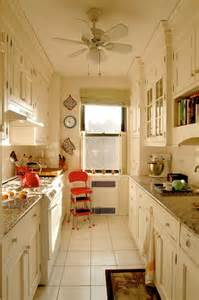 Kitchen layout in white with crown molding via apartment therapy