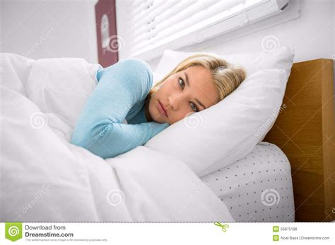 bed disorder woman in bed with eyes open insomnia can t sleep during daytime anxiety stock photo