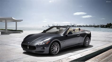 gray maserati maserati grancabrio 2011 in grey side pose at sea side