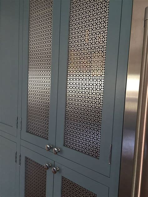custom aluminum cabinet doors attention to detail in using a custom mesh as a center