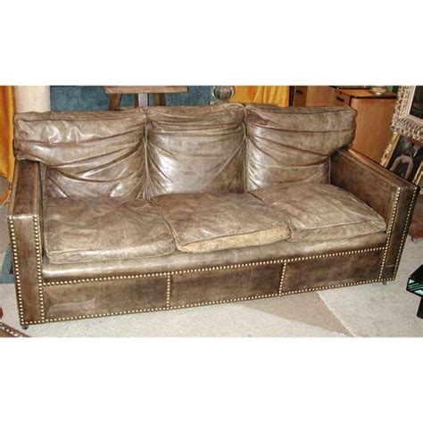 aged leather sofa studded distressed leather sofa and arm chairs at 1stdibs