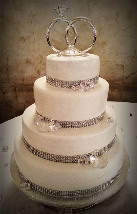 simple amp chic bling themed   tier wedding cake  spiced carrot cake  caramel fill