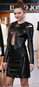 miranda kerr takes to the catwalk in revealing slashed leather outfit as she models new