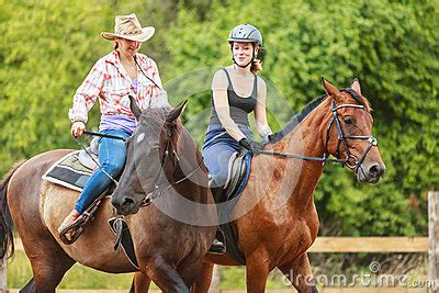 training active ranch women cowgirl and jocket riding horse activity stock