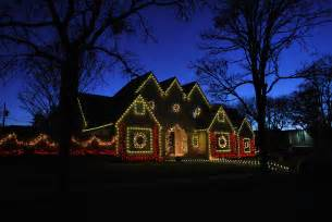 lights on house with light installations in dallas park cities