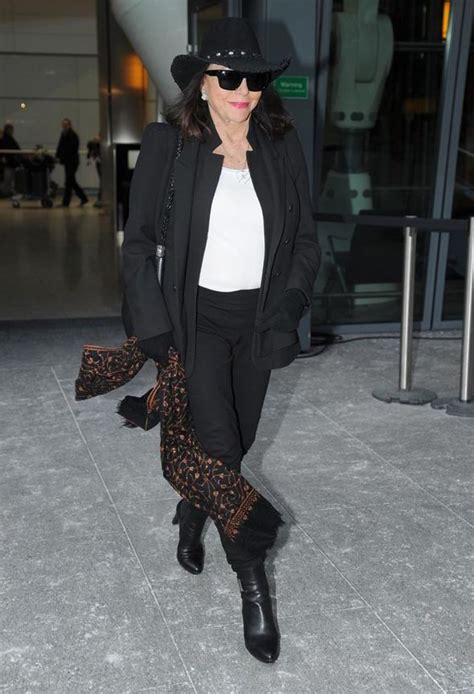 joan collins  super chic  black  white   arrives  heathrow airport celebrity