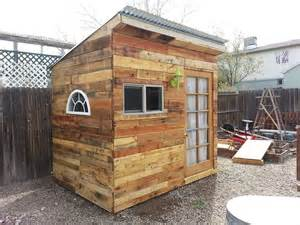 Hometalk building a garden shed from pallets