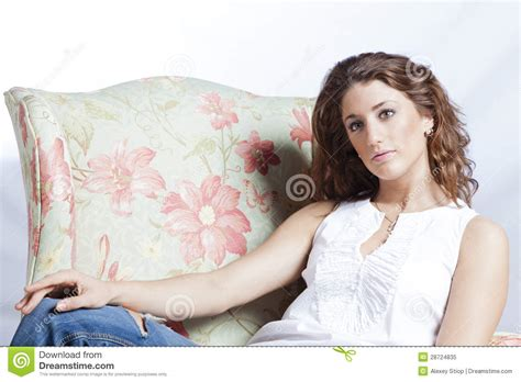 woman in armchair attractive woman in the armchair royalty free stock photo