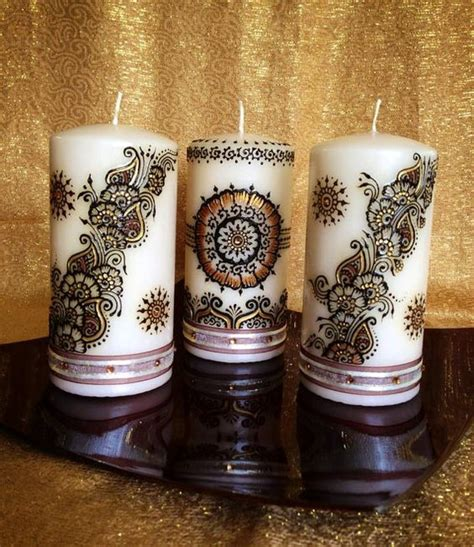 henna design candles set of 3 medium sized henna candles gold and brown on