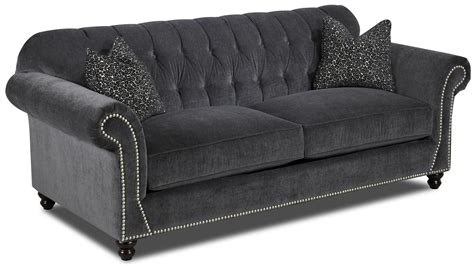 traditional button tufted sofa flynn traditional sofa with button tufted back rolled