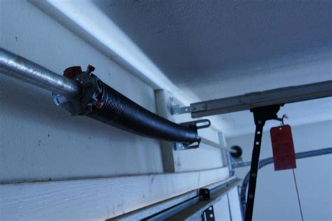 Garage Door Torsion Springs How They Work How Long They Tightening Garage Door Springs