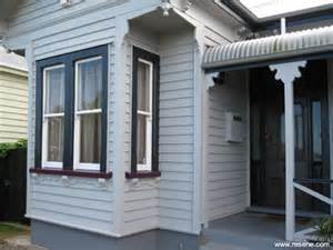 Exterior Paint Color Combinations Dulux - a grey baseds exterior colour scheme in keeping with the age of this villa