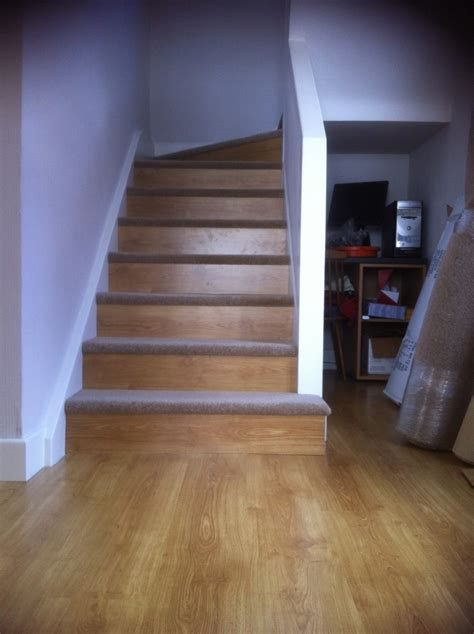 Laminate Flooring Diy Our Diy Staircase Using Leftover Laminate Flooring On The Risers Carpet From Freecycle On The