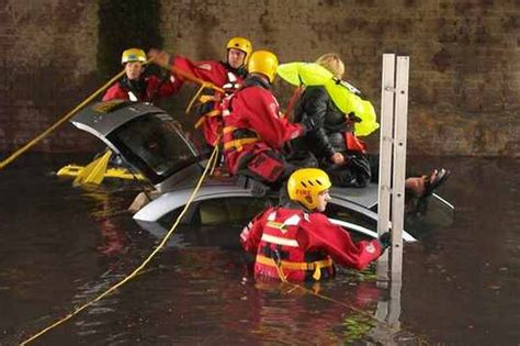 adopt a service dramatic rescue after merseyside driver trapped in rising flood water liverpool echo