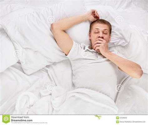 man in bed man in bed stock photo image 57529532