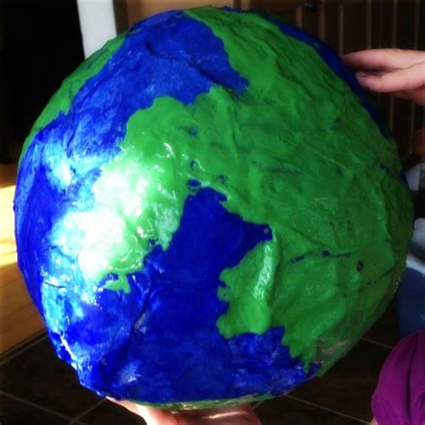 How To Make Paper Earth - paper mache planet earth for earth day momstown national