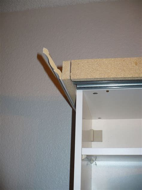 add molding shelving to the top of your kitchen cabinets sliding doors for large shelving units 5