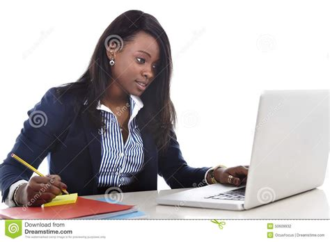 back from sitting at desk attractive and efficient black ethnicity sitting at