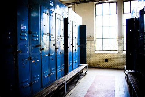 empty locker room empty locker room and benches stock photo colourbox