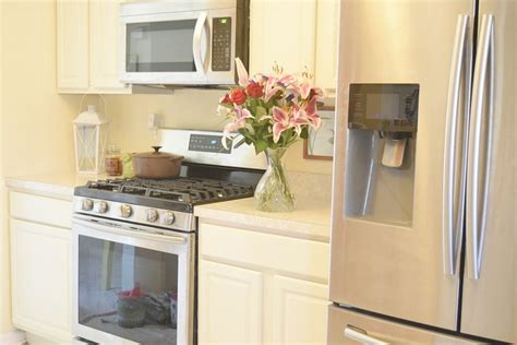painting oak kitchen cabinets white white painted oak kitchen cabinets reveal momhomeguide com