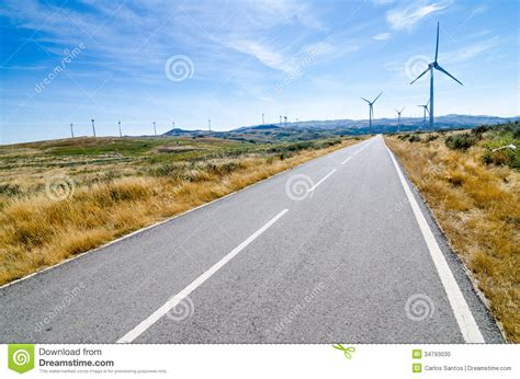 paving the road to inspired empowerment thought reflection t a r books wind turbines stock photo image 34793030