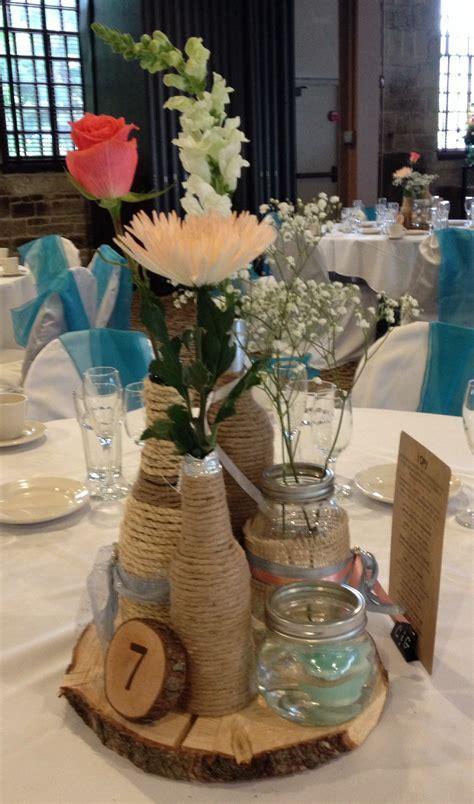 Rustic Wedding Centerpiece. Twine wrapped wine bottles