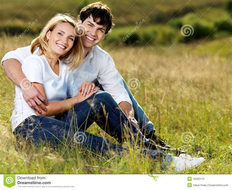 And Couples Beautiful Sitting In Meadow Stock Photos Image