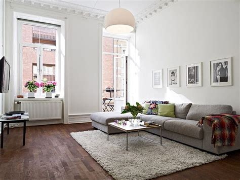 grey sofa with dark wood grey sofa on wooden floorboards dream home living room