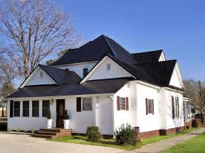 white exterior with black metal roof house colors