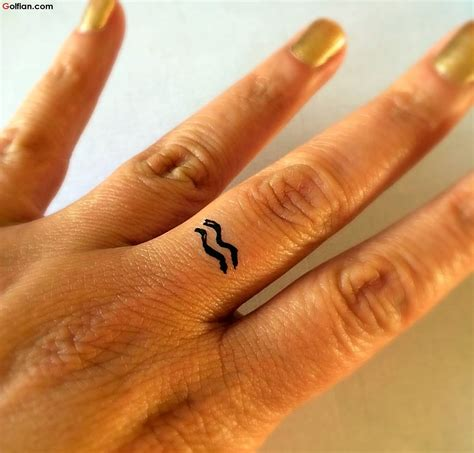 aquarius wrist tattoos black aquarius sign on wrist