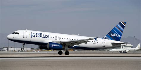 jetblue policy jetblue to add bag fees cut legroom today