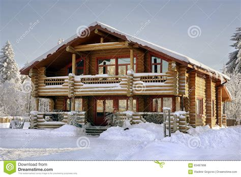 wooden russian house in winter covered with snow stock log house covered in snow during winter stock photo