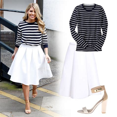 mollie king wearing striped sweater and white midi skirt