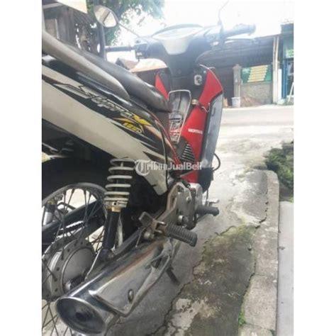 Pelindung Mesin Supra X 125 supra x 125 tahun 2005 warna merah silver kondisi mesin motor terawat dijual tribun