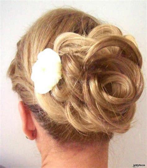 acconciatura con fiore foto 1 acconciature da sposa capelli raccolti