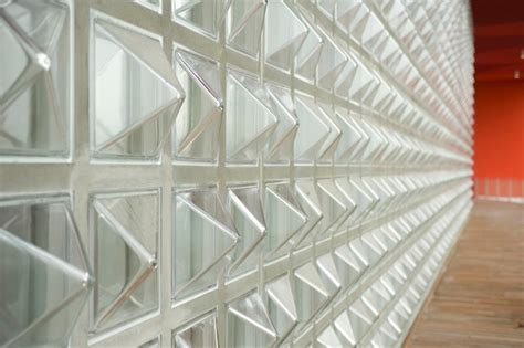 Pyramid shaped glass blocks for a partition wall for a