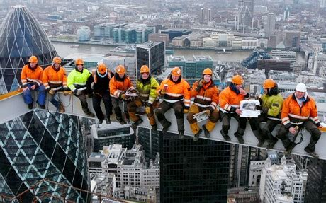 posing construction workers face sack telegraph