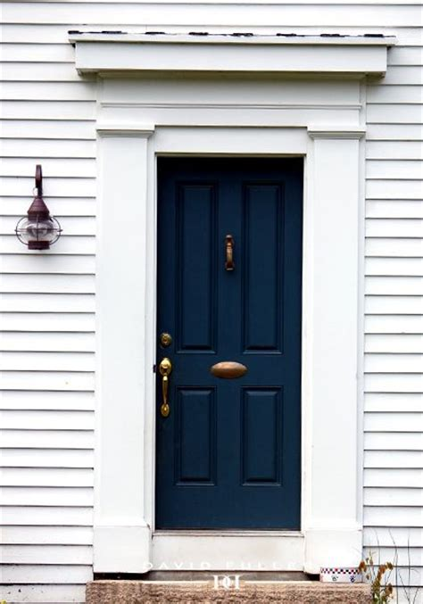navy blue door maybe light mossy green house with dark blue door and