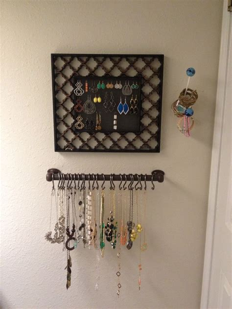 shower curtain rod holders necklaces are hanging on a towel rod with shower curtain
