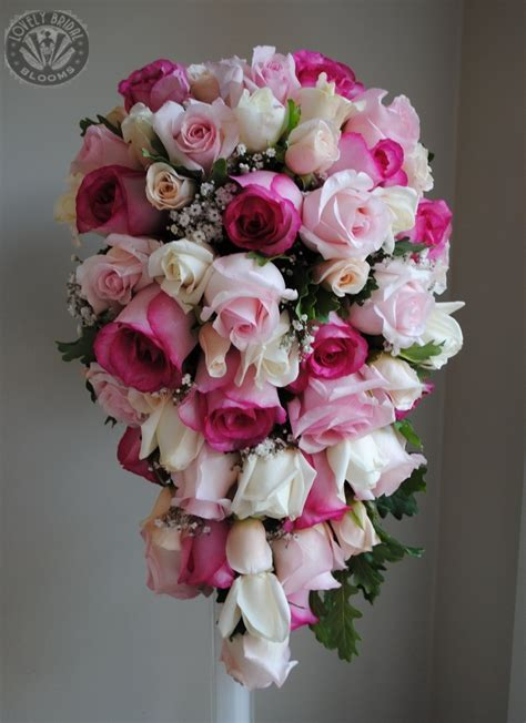 Shades of pink and white roses trailing teardrop bouquet