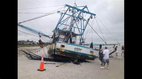 shrimp boat stuck on ormond beach shrimp boat runs aground man jumps overboard