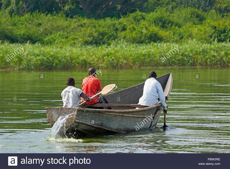 boat with four oars and three rowers rowing boat oars stock photos rowing boat oars stock