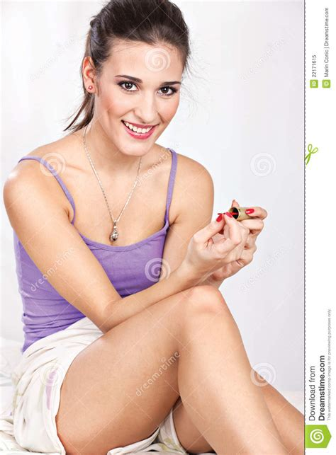 pretty in bed in bed applying nail royalty free stock