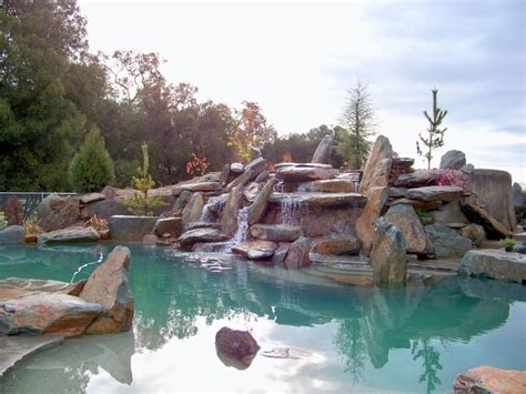 Natural rock boulder pool rustic pool sacramento by spring creek watergardens and landscape