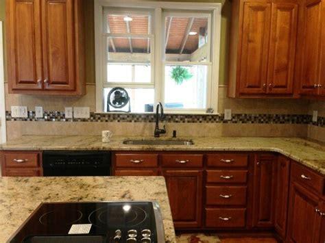 medium brown cabinets with granite countertops sienna beige granite on medium colored wood cabinets 4 9