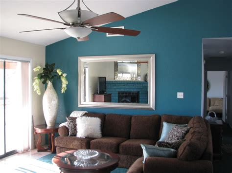 navy blue living room wall will looks harmonious with brown sofa description from