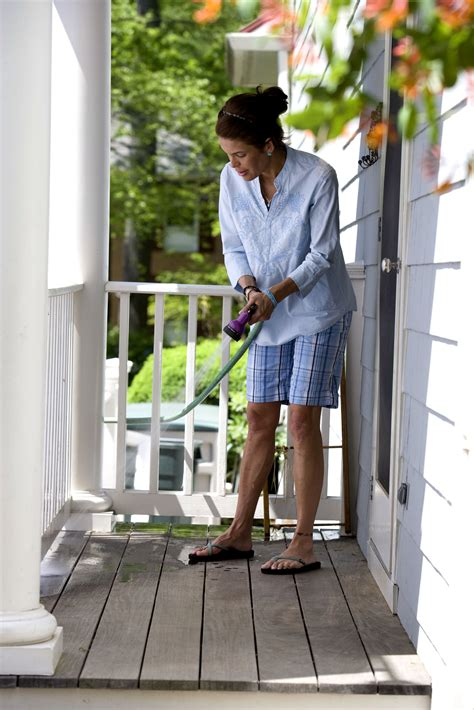 picture women clean floor terrace washing water nozzle