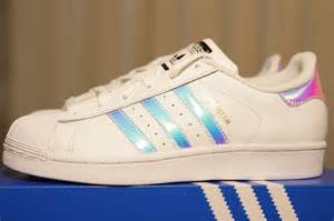 smooth leather upper, iridescent three stripes, and iconic shell toe