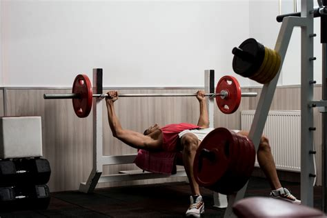 bench press with bar or dumbbells watchfit build up your chest mass bench press vs
