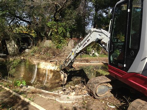 removing a pool from backyard overgrown backyard pool removal carroll bros contracting